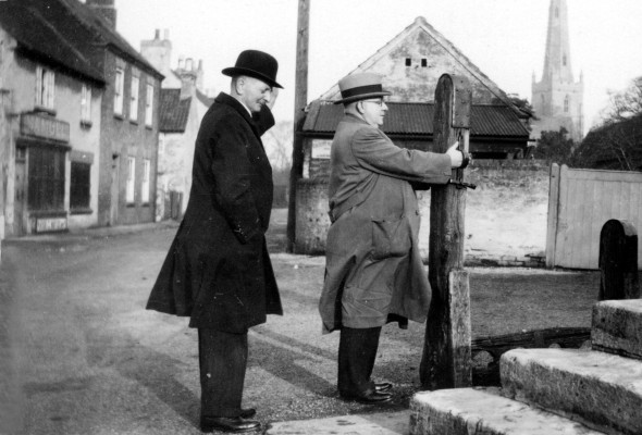 Mr Terry and friend examining the village stocks in Bottesford Market Place | Contributed by Mr Bob Terry