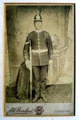 Corporal Frank Norris in uniform - a formal pose taken in a photographer's studio | Mr Gerald Norris