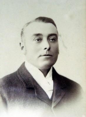 A close-up studio portrait of Mr Frank Norris | Mr Gerald Norris