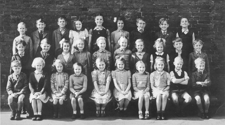 Children at the village school, posed together in the school yard, 1950s. | Neville Spick