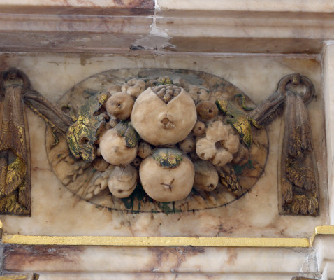A bunch of fruit, believed to be pomegranates, displayed on the tomb of the 6th Earl of Rutland | Neil Fortey
