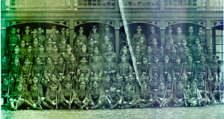 A group photograph of CSM Swallow's Company, location unknown. The comapny are seen in a formal group photograph outside a large building. Alfred Swallow is on the 3rd row 11 from the left. | Viv Finch