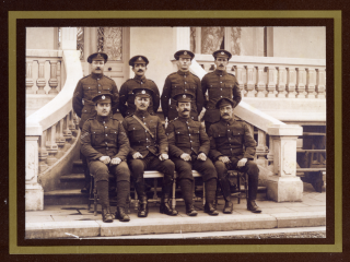 CSM Alfred Bailey Swallow posed with fellow officers at a rest or training camp, location not known. A group of RE offices on the steps pf a country house, possibly in France. | Viv Finch