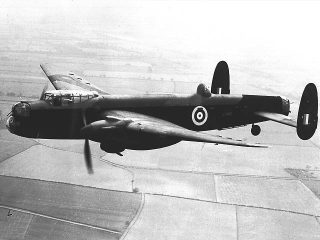 Avro Manchester Mk.1A (L7486) in the air over the fields of Eastern England. | Wikipedia, public domain licence.