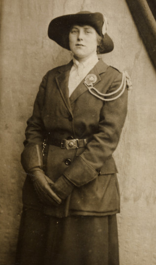 Photograph of Margaret Barrett, sister of Tufnell Barrett. Her uniform may be that of the Queen Mary's Army Auxiliary Corps, a women's unit within the British army, but it also has similarity to the Land Army uniform.