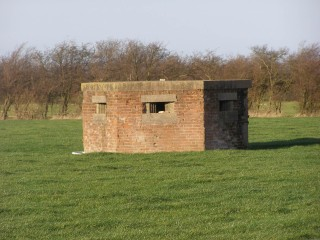 A WW2 defence position still in place in a field by the S-bend of Normanton Lane at the southern end of the village. | Neil Fortey