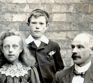 James Schofield, aged 12, seen in a photograph of Barkestone-le-Vale village school in 1904. On the right is the headmaster, W.Cragg, and on the left a girl called A.Stevens. | From the private collection of Mr Denis Kirk. Identification by Sheila Marriott.