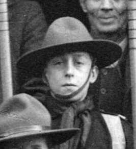 Wilfred Challands, aged 10 or 11, as one of the first troop of Boy Scouts in Bottesford. Here is seen in a photograph parade in front of old cottages (demolished) in Church Street. | Picture from the collection of Mrs Brenda Turier, identification from the Bottesford Scouts archive, courtesy of Mr Ian Kitchener.