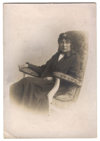 Kathleen Porter in her nurse's cape and uniform. The cap badge displays the Red Cross of the VADs. | Courtesy of the family archive of Mrs Rosemarie Greenhalf.