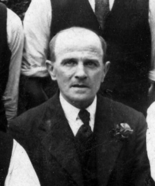 A photograph of Jack Asher, c.1930 or later, as one of the Bottesford Ex-servicemen's Club skittles team, outside the club hut on Albert Street (now the Scout Hut).   From the private collection of Mrs Anne Hewitt