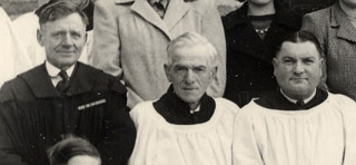 Harry Tinkler, flanked by fellow ex-WW1 servicemen Harry Bugg (to his left) and Tommy Robinson (to his right), in a church choir picture, c.1950.   From the private collection of Miss Margaret Taylor
