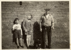 "Robert Johnson Kirton and two boys: ""Melvyn, Julian & Mr Kirton"""