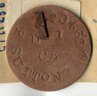 A close up picture of Private Philip Sutton's identity tag.   Private collection