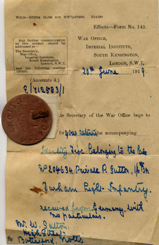 Philip Sutton's soldier's identity tag, and the letter which was sent by an anonymous German soldier in June, 1919 to his family. | From a private collection.
