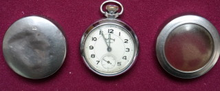 Ernest Wakefield's 'Service' pocket watch and dented protective case   From the collection of Mr. & Mrs. M Wakefield