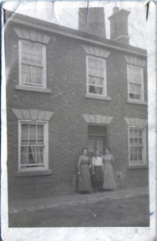 John Richard Robinson's mother and two sisters (Victoria,centre, known as 'Queenie' and Annie, right) standing outside the Mill House on Queen Street Bottesford before WW1. Queenie subsequently ran the White Lion in Melton Mowbray after parents moved on to other business ventures. | From the collection of David Hampson