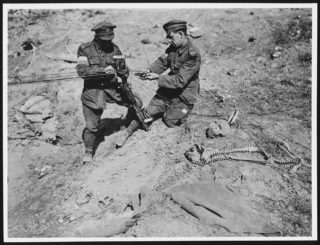 Canadian Signallers using a German rifle as a telephone pole | https://digital.nls.uk/74549212. Creative Commons Attribution 4.0 International Licence