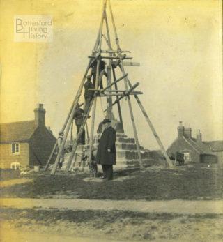 Reverend Nugee supervising the restoration of Muston market cross, 1912. | Courtesy of Julian Walker