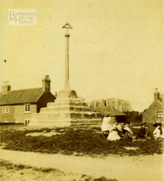 Village children picnicking on the village green by the newly restored cross, Muston, 1912. | Courtesy of Julian Walker