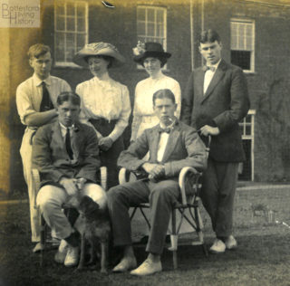 On the lawn behind Muston Rectory, c.1913. L-R: Regie Richards, Francis John Nugee (seated), Laura Nugee, Elizabeth Nugee, Andrew Nugee (seated), George Nugee. | Courtesy of Julian Walker