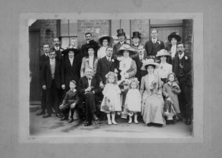 Tommy Robinson (back row, 3rd from right) wearing a top hat at the wedding of his sister Mary. | From the collection of the late Mr Geoff Parr