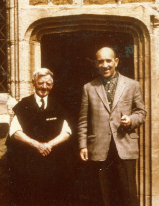 Tommy Robinson (left) and another gentleman by the south door in the chancel at St Mary's, Bottesford, probably in the 1960s.   Bottesford Local History Society archive
