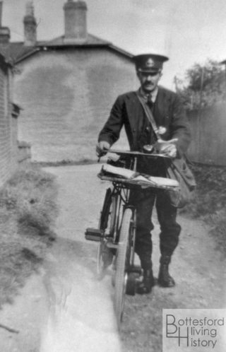 Harold Brewster, the village postman, on his round in Church Lane, Bottesford | From the family archive of the late Mrs Dorothy Beedham