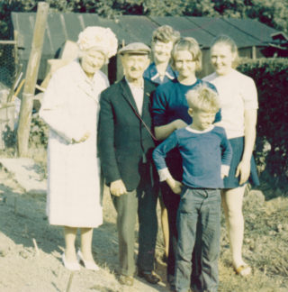 In the gardens at South Normanton: from the left - Doris Dawson, Norman Dawson (wearing cap), Audrey McCraight (nee Dawson) and Audrey's three children Hilary, Linda and, standing at the front, Ian. | By courtesy of Mr Ian McCraight.