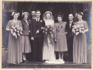 A family wedding, c.1950, St Andrew's, Nottingham. Norman Dawson is standing to the left of Doris. | By courtesy of Mr Ian McCraight, Norman Dawson's grand-son.