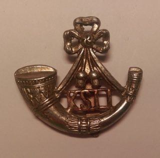 Kings Shropshire Light Infantry cap badge   By Dormskirk - Own work, CC BY-SA 3.0, https://commons.wikimedia.org/w/index.php?curid=45877139