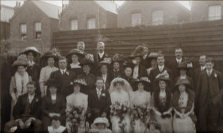 A picture from the wedding of Herbert Wright Hudson and Mabel Anne Piggott, 12th April 1912 at Norbiton, Surrey. To Herbert's left (as seen in the picture) are his sister Beatrice Goodson, mother Mary and brother Frederick. Frederick Hudson, also a teacher who returned to live in Bottesford in his old age, was capped playing cricket for Leicestershire. | From the Hudson family archive, courtesy of Mr Jonathan Hudson.