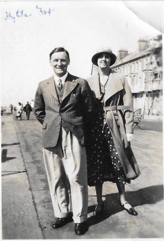 A holiday snapshot of Herbert Wright Hudson and Mabel Hudson on the promenade at Hythe, Kent, in 1934. | From the Hudson family archive, courtesy of Mr Jonathan Hudson.