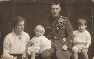 Taken in April/May 1916 in Kingston, at the time Herbert Hudson transferred from the Leicestershire Militia to the Royal Artillery, this picture shows Mabel and Herbert with their sons Herbert and Frederick. The people in the picture are, from the left, Anne Mabel Hudson, Herbert Alexander Hudson, Herbert Wright Hudson, Frederick Dennis Hudson. | From the Hudson family archive, courtesy of Mr Jonathan Hudson.