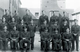 F/O (126448) (Thomas) John Phillips, Air Bomber 467 (R.A.A.F) Sqdn - seated far right - unknown location