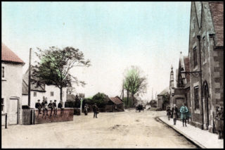 A street scene c.1920 showing Grantham Road looking east, with the Red Lion on he left and the village school on the right.   Courtesy of Mrs. Betty Smith