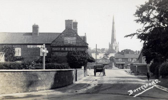 Postcard of Market Place showing Bugg's butchers shop.