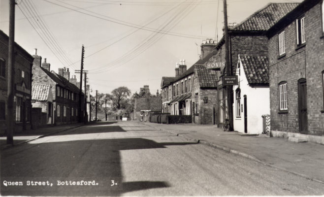 Postcard of Queen Street, looking northwards, old Coop on left.