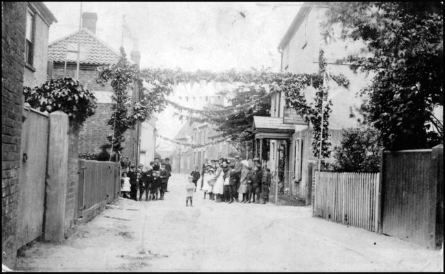 Chapel Street, children and bunting, 1911 Coronation celebrations.