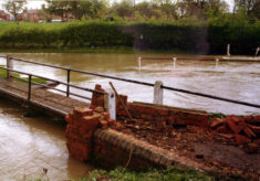 Damaged footbridge at ford on Rectory Lane during flooding.