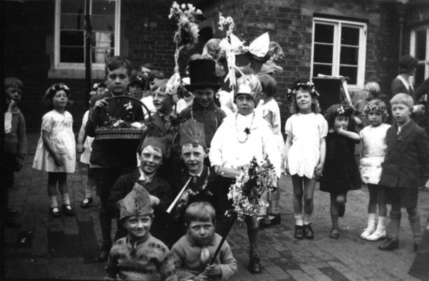 Children prepare for May Day celebrations, 1953 Coronation Year.