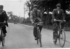 Three men cycling to or from work, Belvoir Road