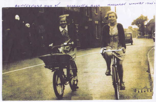 Cycling through Bottesford in the 1940s, Charlotte Bugg and Margaret Waudby, | From the collection of Philip Sutton