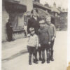 Queen St, c.1933 - Evelyn Marston with sons Vic, Frank and John