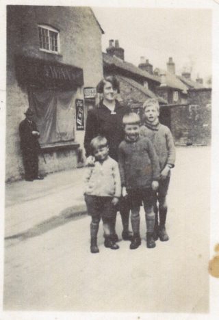 By Winn's store, c.1933. Evelyn Marston with her boys: John, Frank and Vic (oldest). | The Marston family