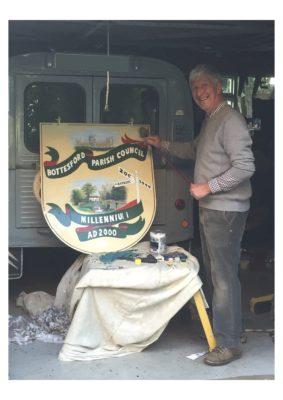 Cob George restoring the Millennium Beacon sign