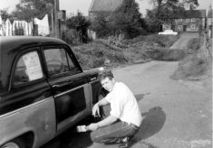 Man painting a car, by Devon Lane, Bottesford