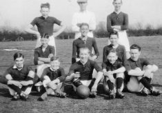 Bottesford football team, and a group of admiring schoolboys.
