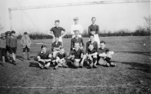 Bottesford football team, and a group of admiring schoolboys. | Mrs Anne Hewitt, Bottesford Local History Archive