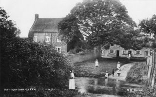Children by the ford through the River Devon at The Green, circa 1900.