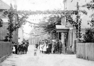 Coronation celebrations in Chapel Street, 1911, with Singleton's House (sadly, demolished in the 1960s) on the right.